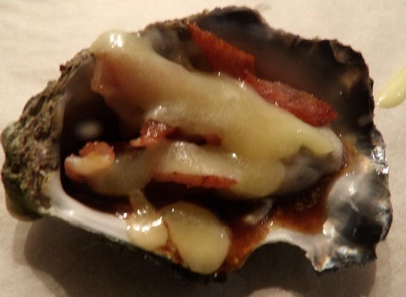 putting,sauce,on,oysters  - Fresh Oysters Kilpatrick