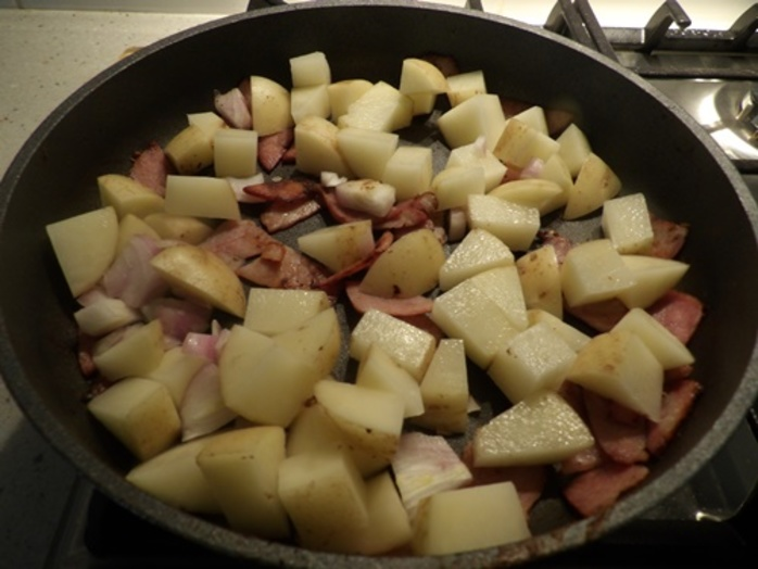 cooking,potato,cubes,and,bacon