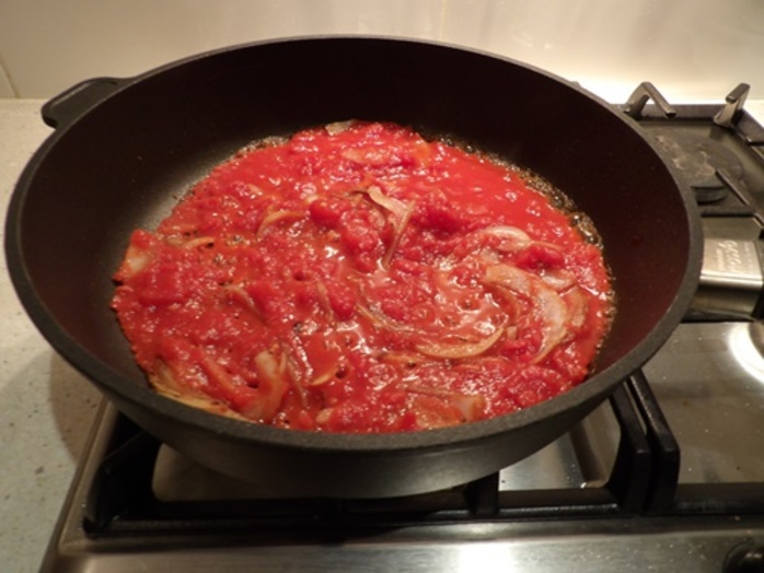 cooking,tomatoes,and,onions,for,eggplant,layers