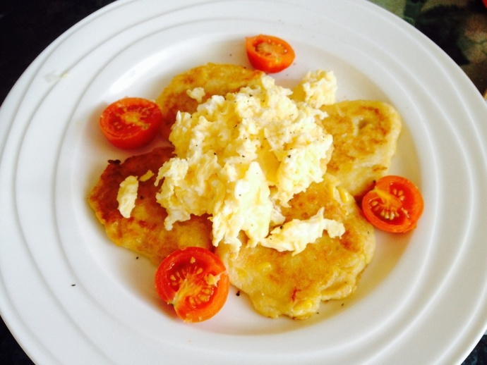 Corn pancakes with scrambled eggs
