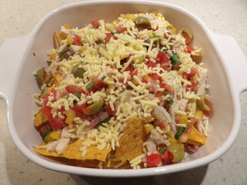 adding,salsa,to,cheese,and,corn,chips  - Corn Chips with Homemade Tomato Salsa, Chicken, and Egg