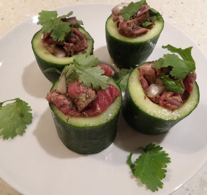 cucumber,cups,filled,with,spicy,Thai,beef,salad
