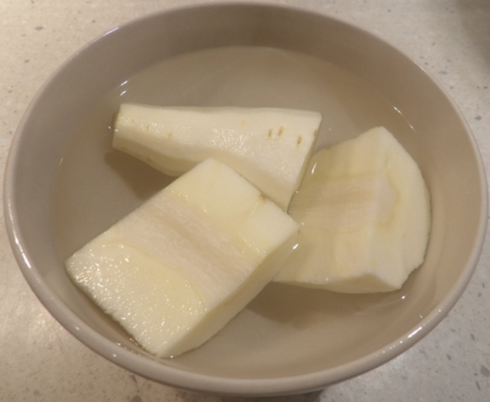 cutting,parsnip,and,pouring,boiling,water,over,it