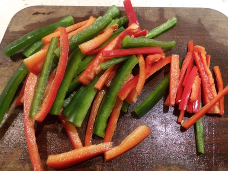 cutting,red,and,green,capsicum,for,chili,chicken  - Chili Chicken with Pine Nuts and Guacamole