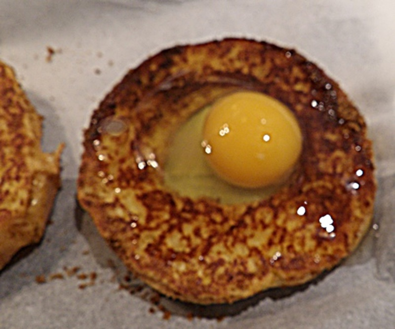 cutting,hole,in,bread,for,egg,to,go,in  - Brunch - Baked Eggs in a Hole