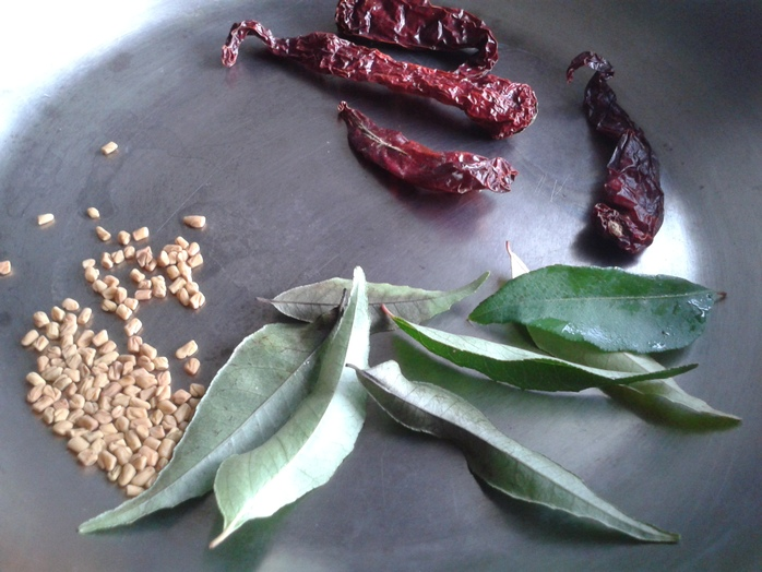 Dry roast red chilli, fenugreek seed and curry leaves