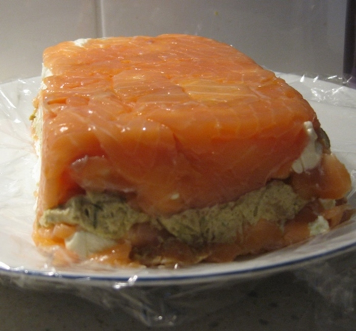 Finished,terrine,encased,in,smoked,salmon