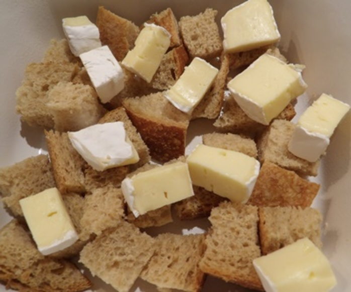 cutting,camembert,cheese,into,cubes,for,strata