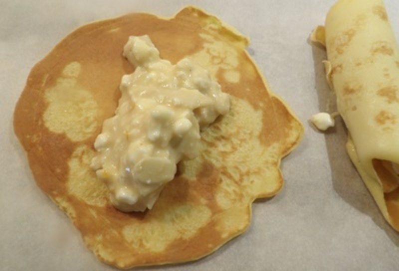 laying,filling,on,each,crepe