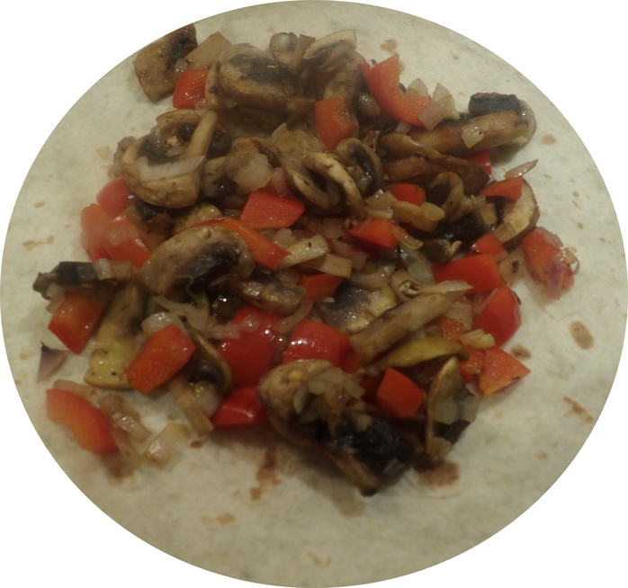 adding,onion,and,red,capsicum,to,mushrooms