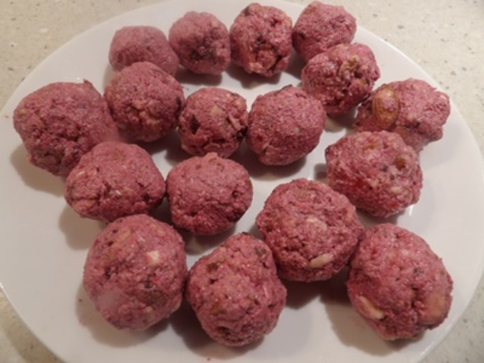 Mixing,ingredients,for,raspberry,bliss,balls