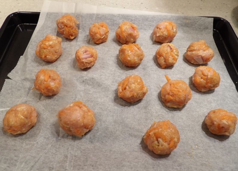 mixing,raw,chicken,mince,with,carrots,and,onions  - Chicken Meatballs with Spaghetti
