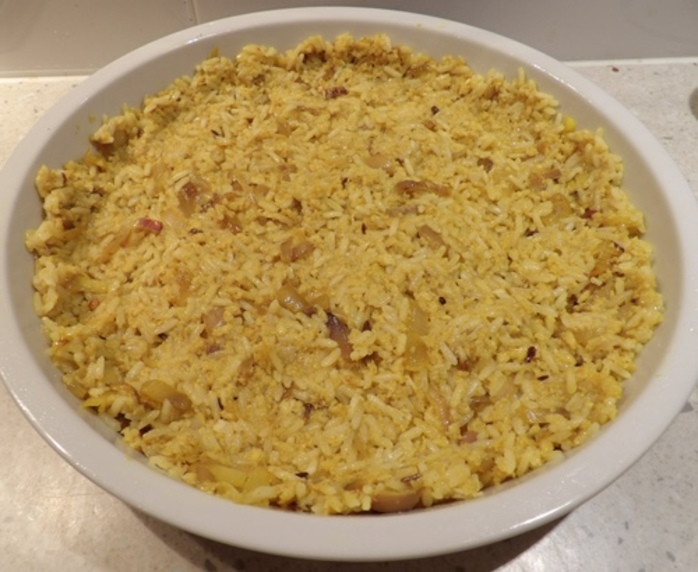 making,rice,base,for,corn,and,chicken,pie
