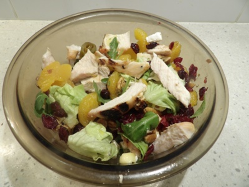 mixing,pecans,with,lettuce,cranberries,and,jalapenos