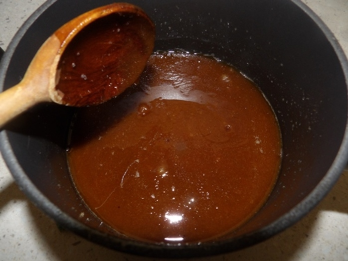 mixing,caramel,for,almond,chocolate,slice