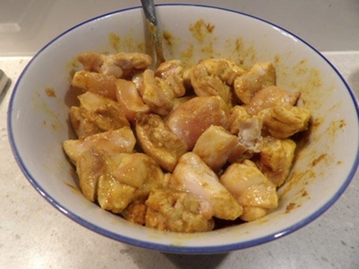 mixing,chicken,with,peanut,butter,sauce