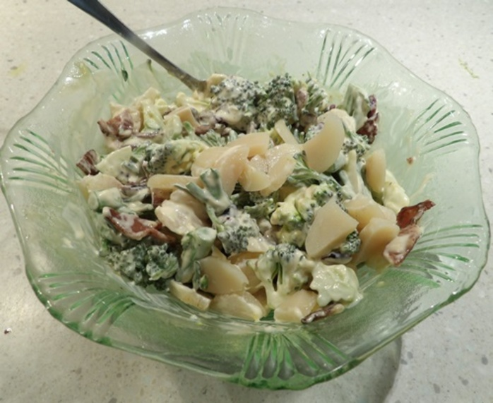 mixing,mayonnaise,sour,cream,and,vinegar,for,salad