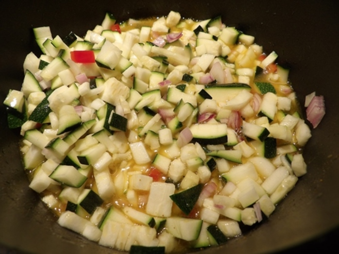 cutting,up,zucchinis,onion,capsicum,for,zucchini,pickle