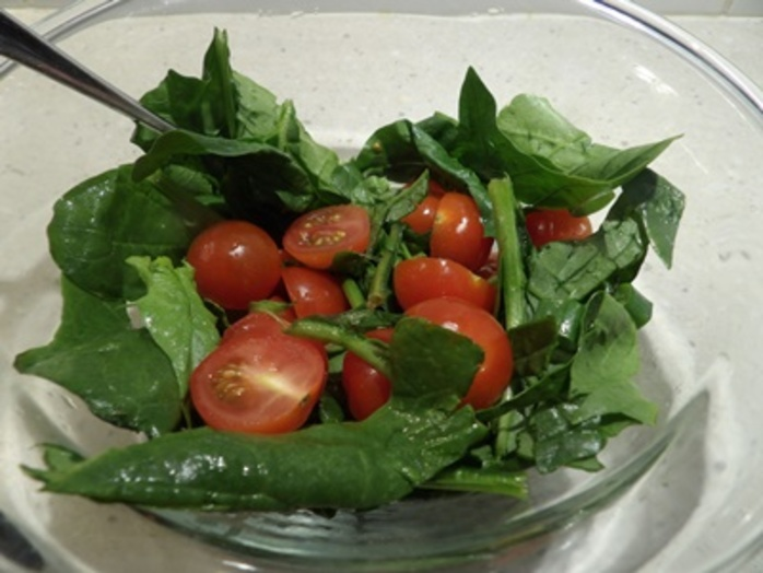 mixing,tomatoes,and,spinach