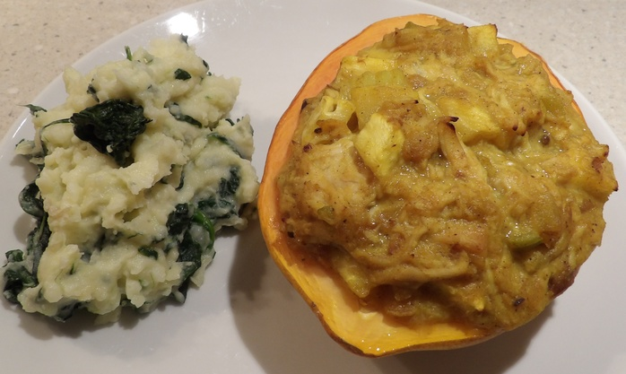 pawpaw,filled,with,curry,chicken,served,with,spinach,puree