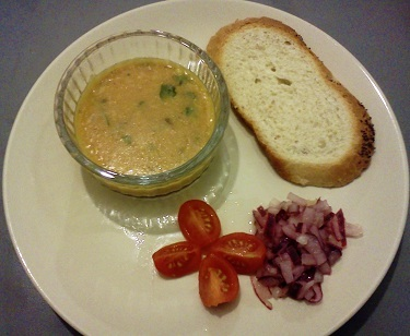 pickled Red onion salad with dahl and bread