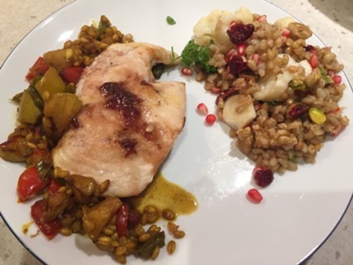 plated,barley,chicken,with,pomegranate,and,barley,salad