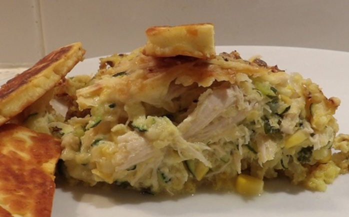 plated,chicken,and,corn,pie,with,rice,base