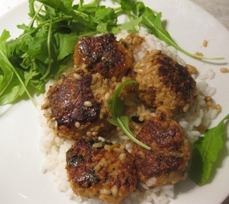 plated,chicken,tiny,balls,on,risotto,with,baby,rocket