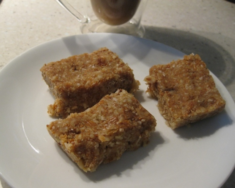 pressing,mixture,into,tin  - Raw Fig, Coconut and Slivered Almond Bars