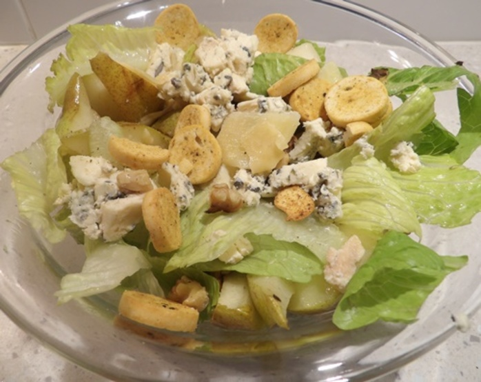 plated,pear,and,walnut,caesar,salad