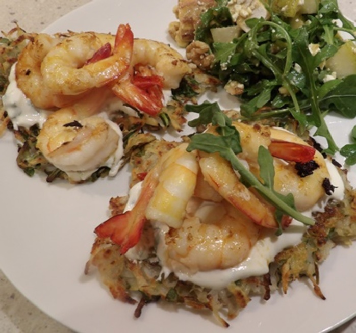 plated,prawn,rosti,with,rocket,salad