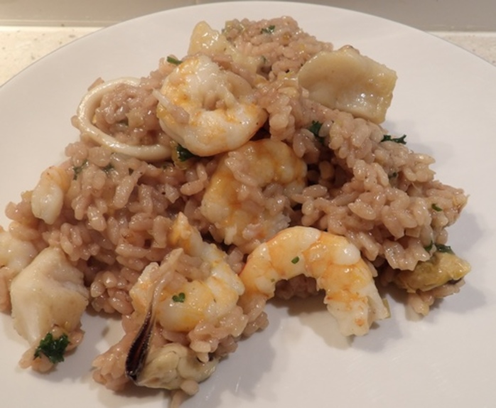 plated,seafood,risotto,with,red,wine