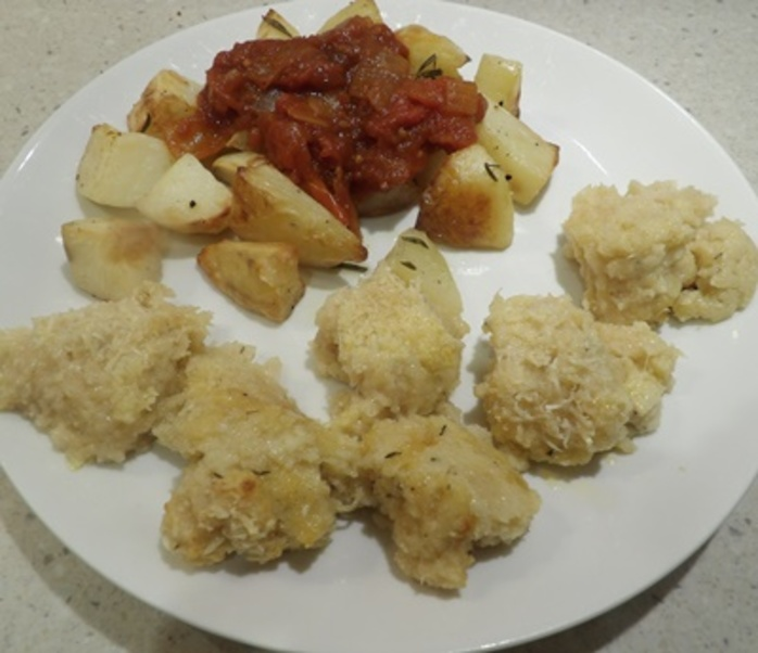 plated,semolina,butter,gnocchi,with,crisp,potatoes,in,fresh,tomato,sauce