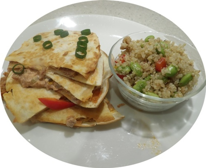 putting,tuna,mix,on,top,of,quesadilla