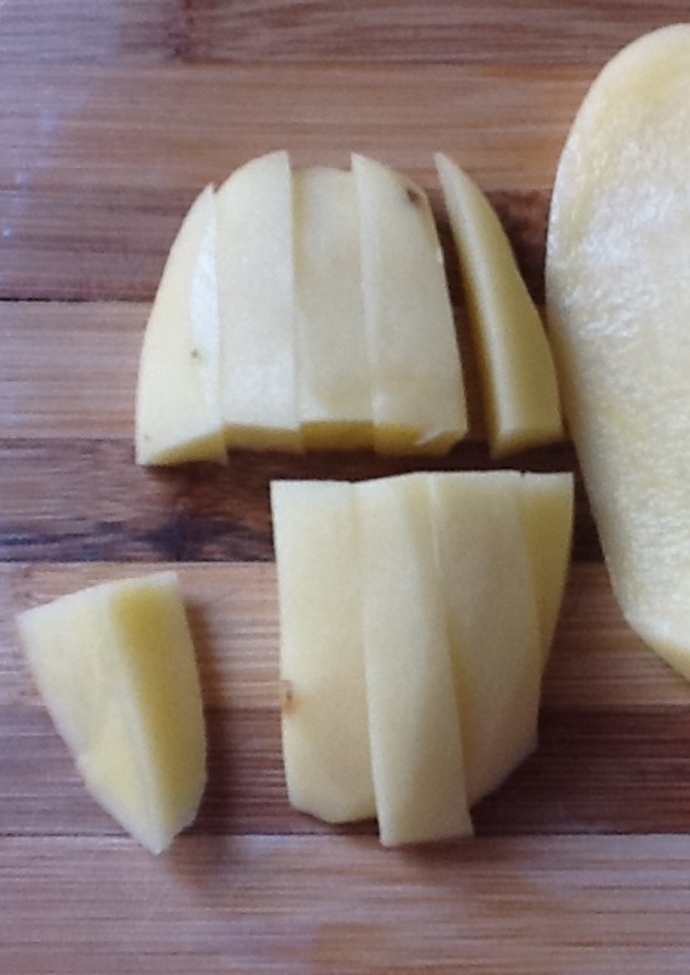 Potatoes cut into thick strips.