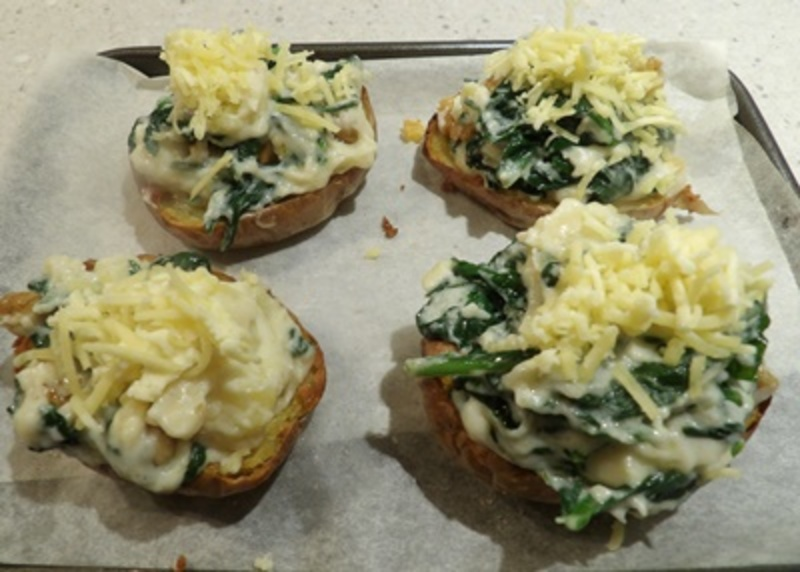 hollowed,out,potatoes  - Baked Crispy Skin Potato with Spinach and Cheese