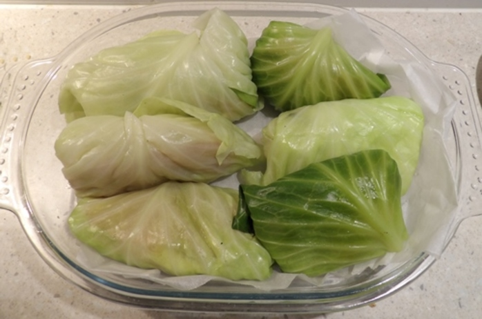 putting,cabbage,parcels,in,dish,ready,for,oven