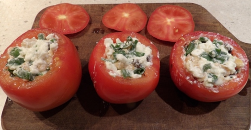 putting,mixture,into,hollowed,tomatoes  - Nutty Tomatoes Stuffed with Cottage Cheese, Anchovies and Served with Mozzarella French Bread