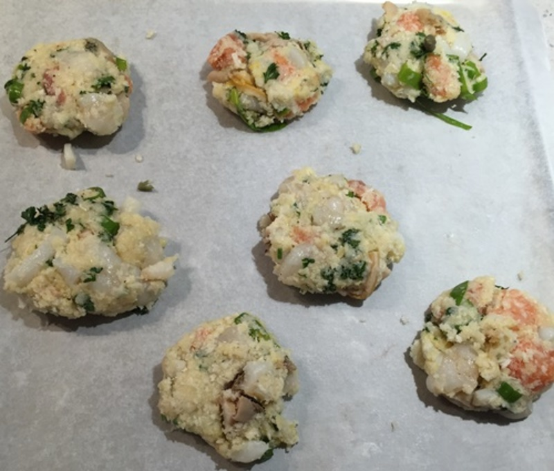 cutting,marinara,into,small,pieces,for,rissoles  - Seafood Cakes with Baked Fat Free Chips