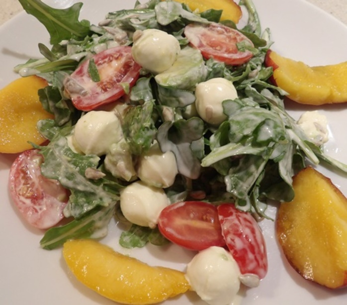 rocket,bocconcini,and,tomato,salad,with,anchovy,dressing
