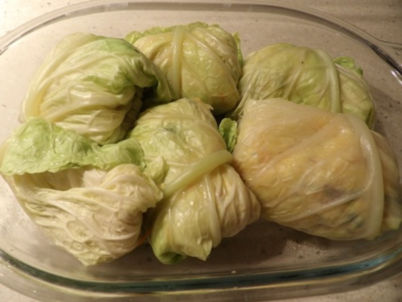 rolled,cabbage,leaves,in,baking,dish,ready,to,cook  - Cabbage Vegetable Parcels With Pumpkin Ricotta Sauce