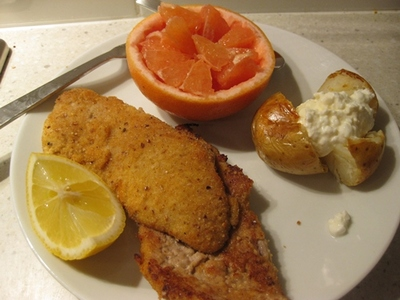 schnitzel,with,grapefruit,and,baked,potato