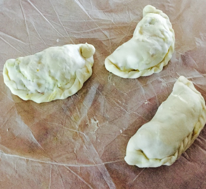 Sealing the curry puffs