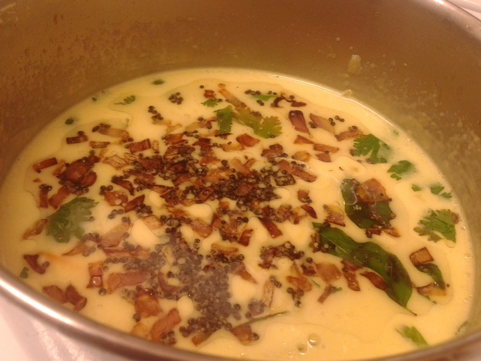 temper mustard seed and saute onion and curry leaves