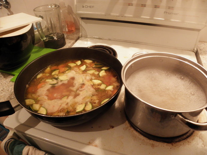 frying the vegetables and bacon