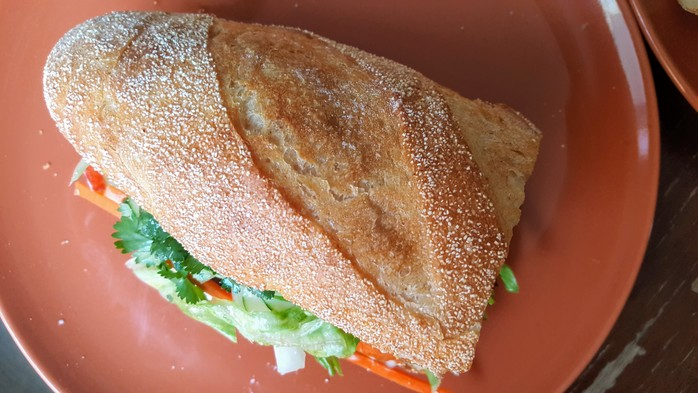 Spicy Beef Banh Mi with carrot, daikon, cucumber, lettuce, chilli, mayo and soy sauce