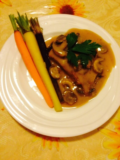 Steak with mushroom sauce and carrots