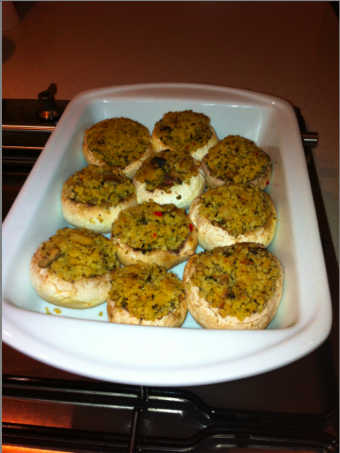 Stuff mushrooms and place into a pre-warmed oven at 180 degrees and bake for 20-minutes or until the tops are golden in colour