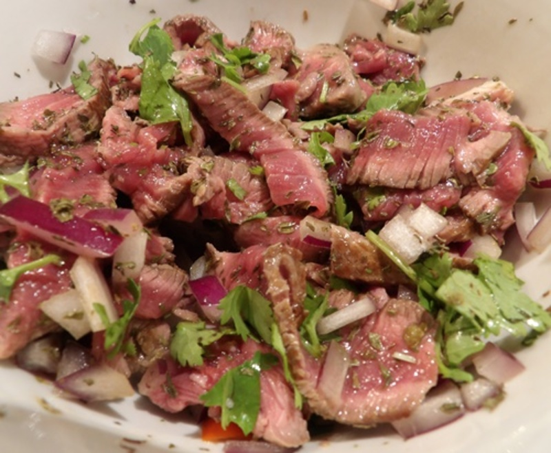 slicing,beef,fillet,into,very,thin,strips  - Cucumbers Filled with Spicy Thai Beef