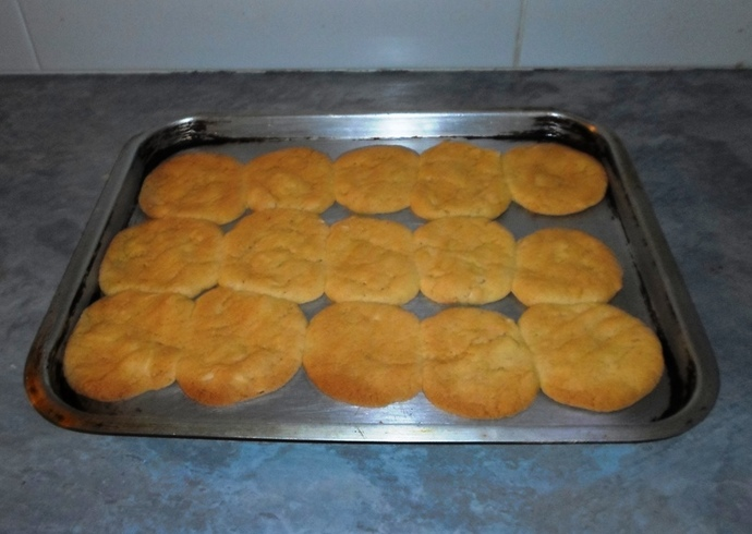 Tray of unbaked almond crisps